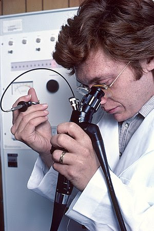 Pictured is a physician using a remotely contr...