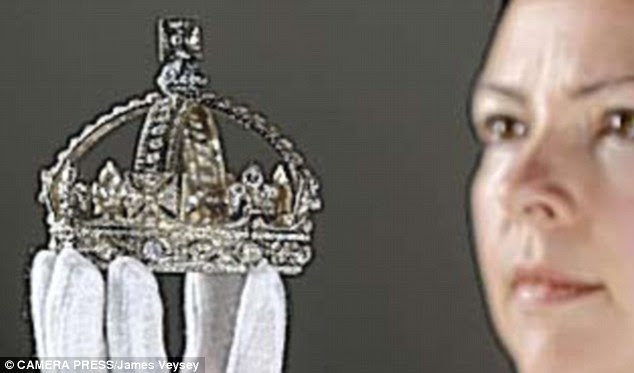 Crown jewels: Queen Victoria's small diamond crown is part of an exhibition at Buckingham Palace