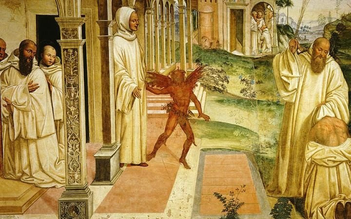 St Benedict of Nursia exorcises the devil from man possessed in a fresco by Giovanni-Antonio Bazzi
