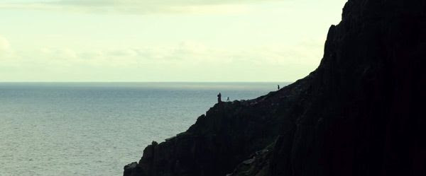 Luke Skywalker (Mark Hamill) watches as Rey trains with her lightsaber in STAR WARS: THE LAST JEDI.