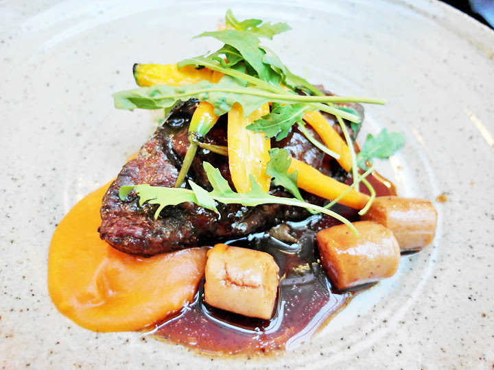 48 hour braised beef cheek with mochi potatoes, carrot puree & pea tendrils