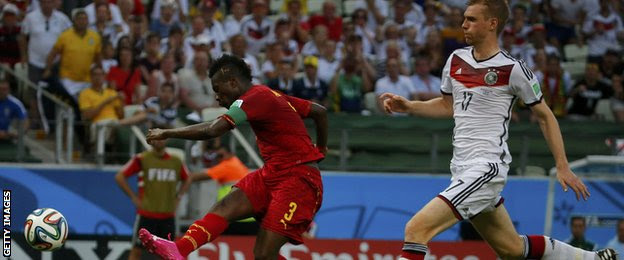 Ghana's Asamoah Gyan (left) scores against Germany