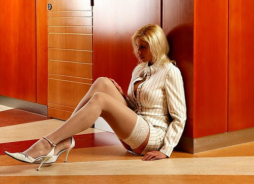 Picture of sexy business woman in nylon stockings and high heels