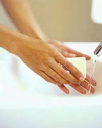 Info: Person washing hands in sink