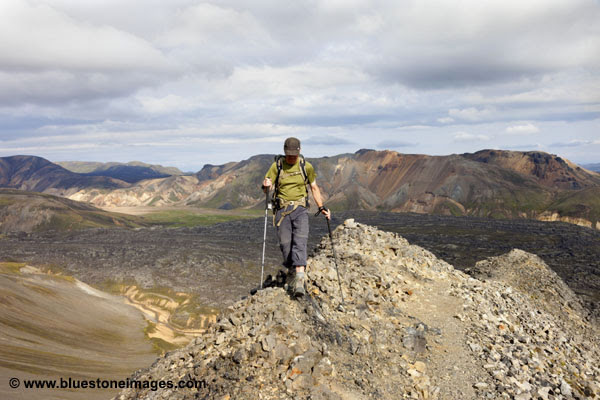 06D-1540 Walker Ascending the Mountain of Blahnukur via the North Ridge with the Laugahraun Lava Field Below Landmannalaugar Iceland.