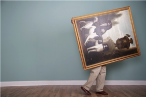 Man moving and storing artwork