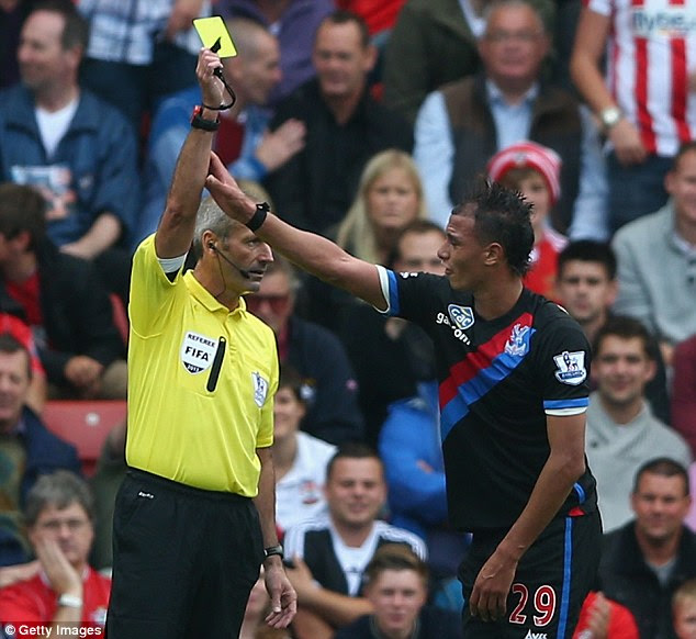 Controversy: Chamakh was booked for diving during a goalscoring opportunity