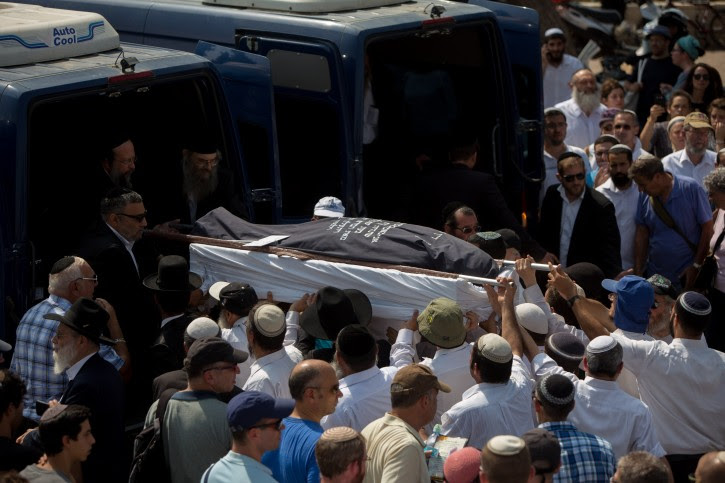 Friends and family carry the bodies of Israeli couple, Naama and Eitam Henkin during their funeral at Har HaMenuchot Cemetery in Jerusalem on Friday, October 2, 2015, Israeli couple, Naama and Eitam Henkin, were shot dead last night while driving by the West Bank settlement of Itamar. Four of the couple's six children were in the car at the time, but were unhurt. Photo by Yonatan Sindel/Flash90