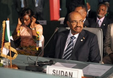 Sudan's President Omar al-Bashir takes part in the African Union Summit on health focusing on HIV/AIDS, TB and malaria in Abuja on July 15, 2013. by Pan-African News Wire File Photos