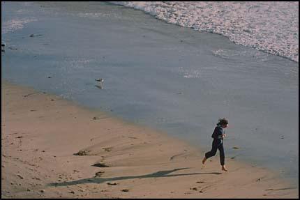 Figure running on beach