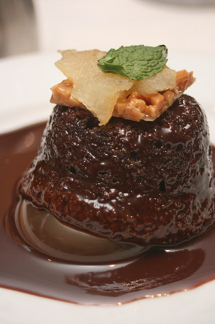 Warm Chocolate Cake (vegetarian) with milk chocolate sauce and sweet roasted pears