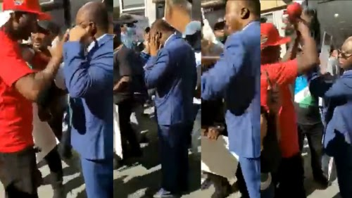 Anti-Buhari Protesters Slap Nigerian Government Official In US (Photos, Video)