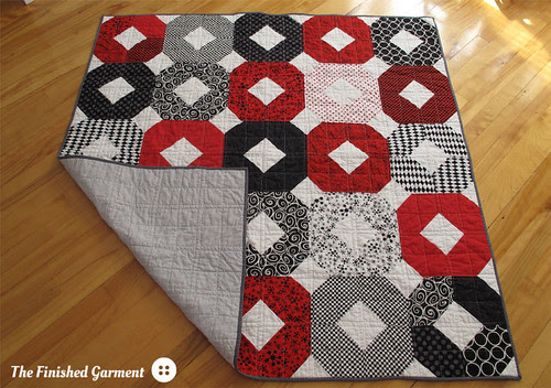 """Red """"X""""s and """"O""""s quilt."""