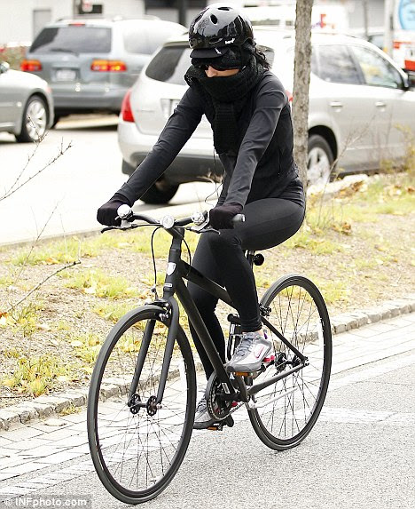 Action girl: Katy Perry goes for a bike ride in New York today