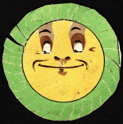 Green cut edged with yellow centre watch-paper, stylised sunflower, with smiley face, in outer case. (1732-1770)
