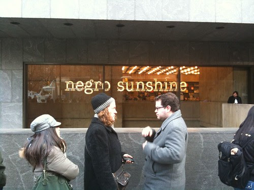 Outside the Whitney Museum (Glenn Ligon neon sign in window)