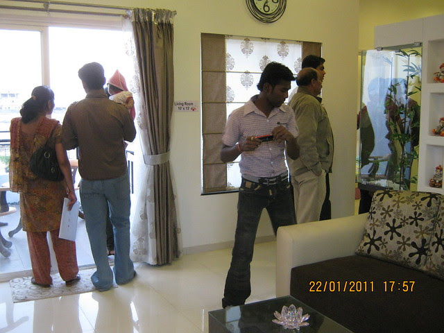 Visit to Neo City 1 BHK & 2 BHK Flats at Wagholi Pune 411 027 - property buyers admiring the 2 bhk sample flat