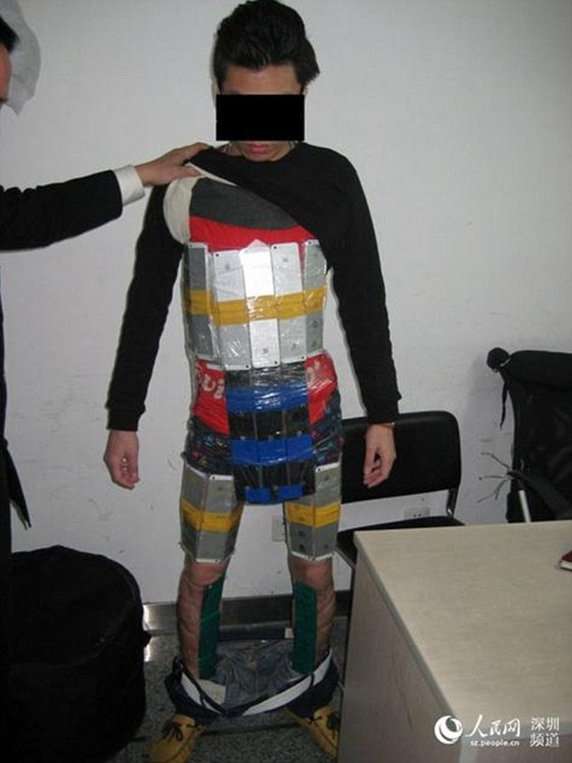 Foiled:A smuggler was caught trying to sneak 94 iPhones into China by strapping and concealing them around his torso
