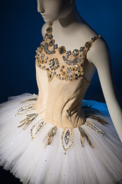 white skirt with beige bodice and jewels