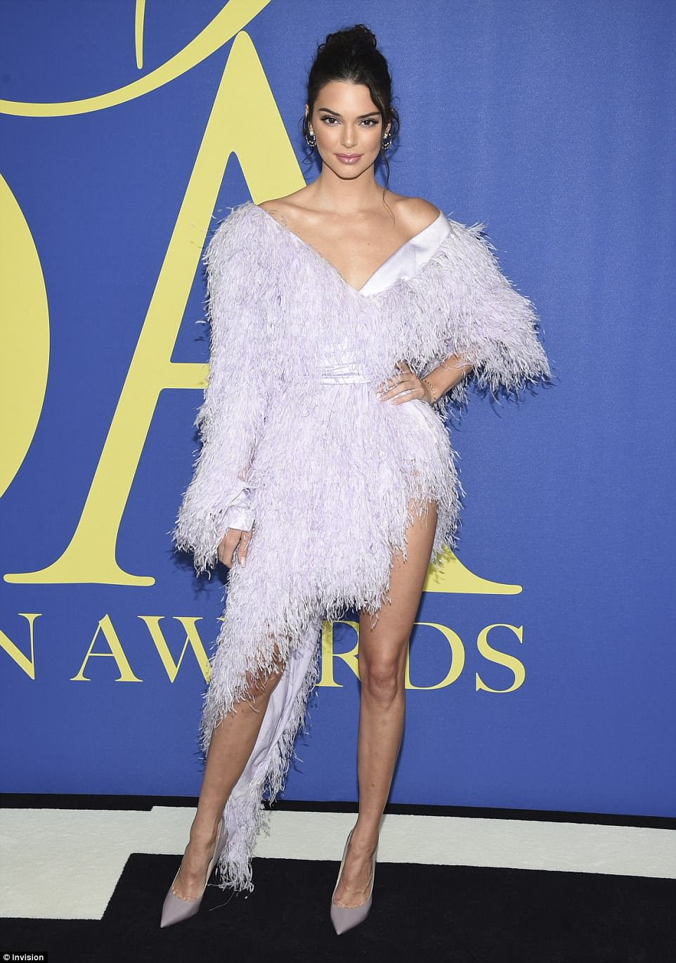 Catwalk sensation: Kim's sister Kendall Jenner dazzled in a pale lilac feathered off-the-shoulder Alexandre Vauthier number