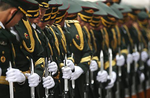 German President Joachim Gauck visits China...epa05223963 Chinese honour guards adjust their attire before a welcome ceremony for German President Joachim Gauck at the Great Hall of the People in Beijing, China, 21 March 2016. The German President is on a five-day state visit to China.  EPA/HOW HWEE YOUNG