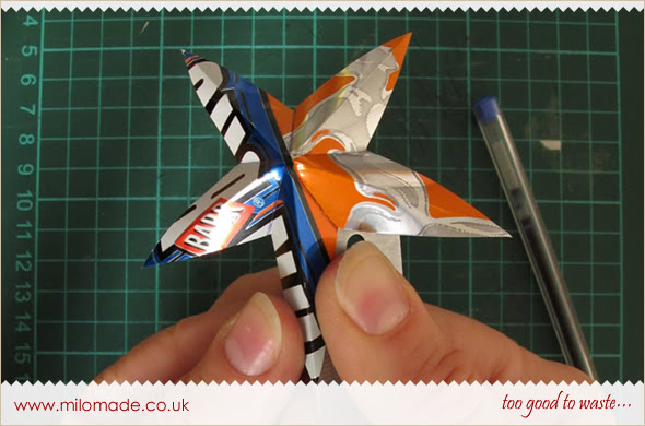 Festive Stars made from Soda Cans - A Tutorial from Milomade
