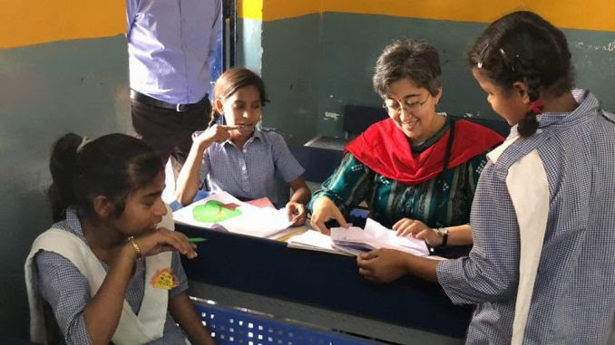 Education minister Atishi with school children in Delhi. Image/AAP
