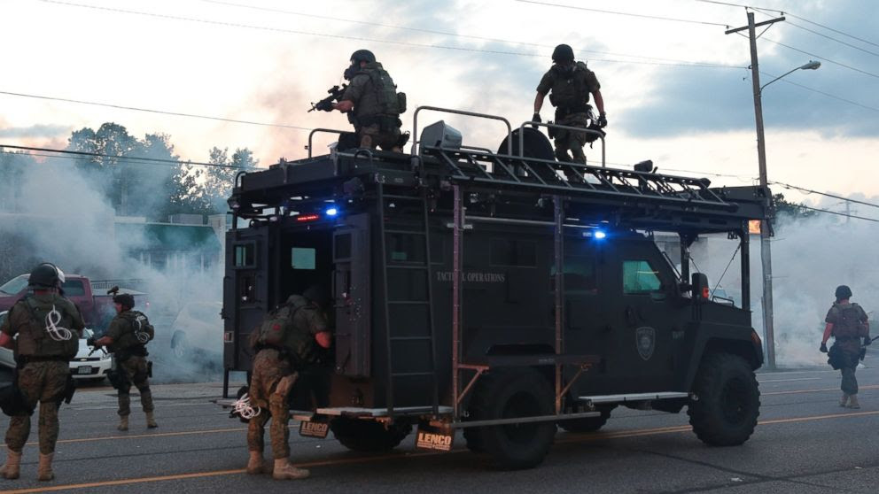 PHOTO: Tactical officers fire tear gas, Aug. 11, 2014, in Ferguson, Mo.