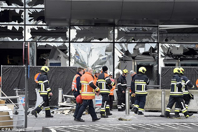 Members of the civil protection outside the damaged front of Brussels Airport, in Zaventem, a year ago today. The attacks left dozens dead and hundreds injured