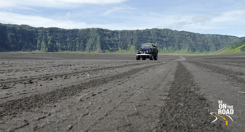 The sea of sand and the iconic Land Cruiser near Mount Bromo, Indonesia