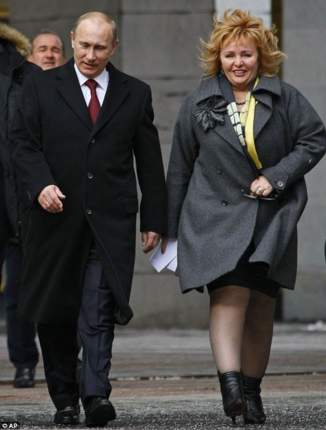 Russian President Vladimir Putin, left, and his wife Lyudmila, seen in March last year