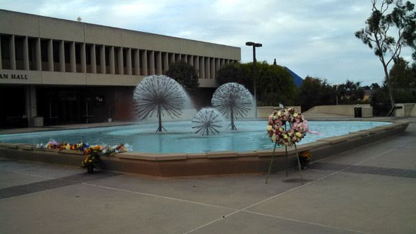 A wreath and flowers are placed near the Lyman Lough fountain at CSULB's Brotman Hall...in honor of Nohemi Gonzalez on November 15, 2015.
