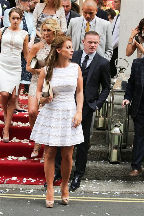 Coleen and Wayne Rooney don their finery for Tom Cleverley
