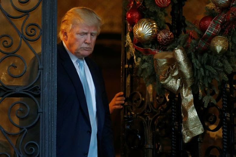 U.S. President-elect Donald Trump walks out to deliver brief remarks to reporters at the Mar-a-lago Club in Palm Beach, Florida, U.S. December 28, 2016. REUTERS/Jonathan Ernst