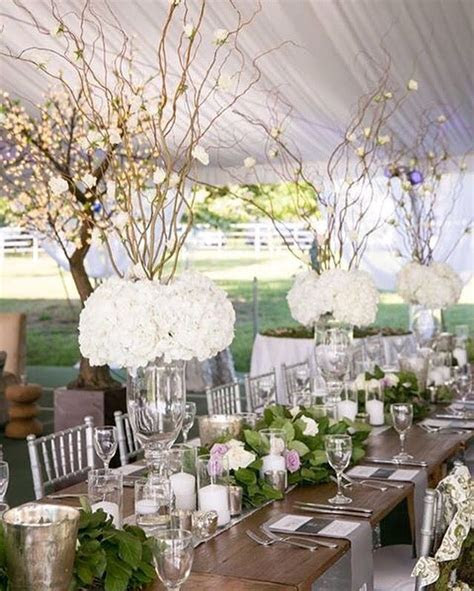 Adding the silver chiavari chairs, tall hydrangea