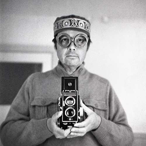 reflected self-portrait with Ricoh Auto 66 camera and lensless spectacles by pho-Tony