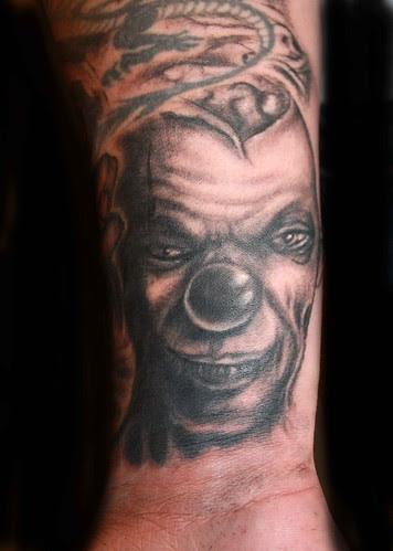 evil clown tattoos. scary clown