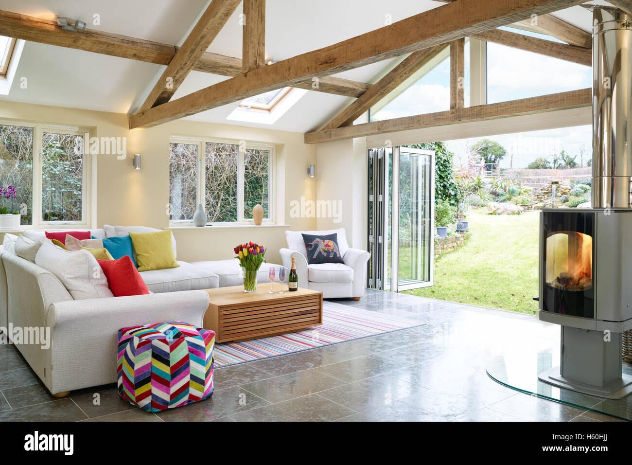 A fresh, modern extension, garden room with wood burner ...