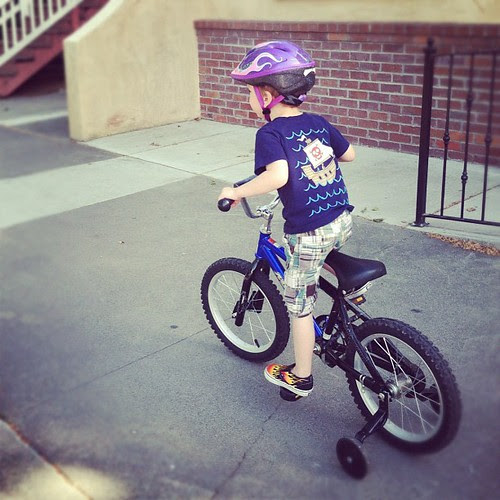 Such a cool kid riding his bike (and yes, his shirt is on backwards)