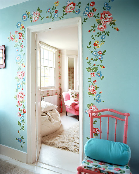 Bedroom - A pink chair beside blue walls decorated with flowers