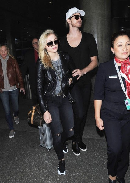 Chloe Grace Moretz 'Kick-Ass' actress Chloe Grace Moretz arriving on a flight at LAX airport in Los Angeles, Calfiornia with her brother Trevor on March 12, 2015. Chloe is returning from France where she attended various events during Paris Fashion Week.
