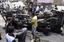 Residents gather at the site of a car bomb attack in Kerbala, 110 km (70 miles) south of Baghdad