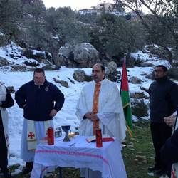 Father Ibrahim Shomali celebrating mass