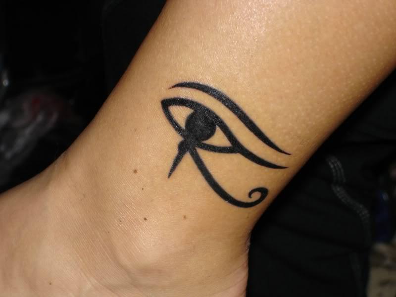 Cute Huros Eye Shape Tattoo Design On Foot Tattoomagz