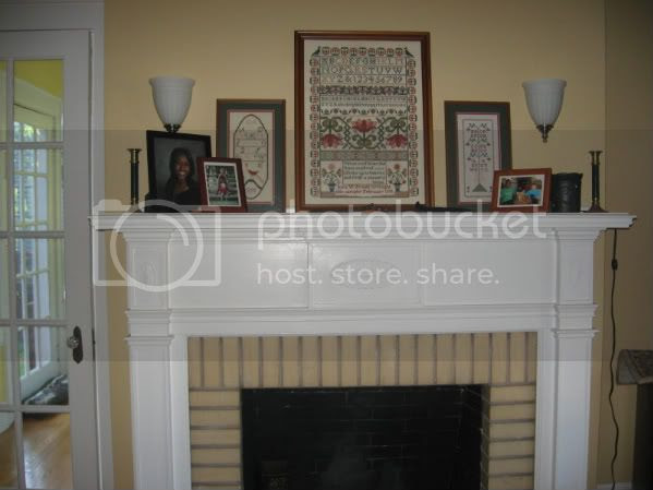 what is over your fireplace? and side sconce lighting