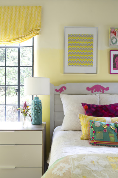 Bedroom - A colorful kids' room with casement windows and a bed topped by throw pillows