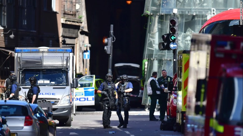 Armed police outside Borough Market, London, Sunday June 4, 2017, near the scene of Saturday night's terrorist incident.