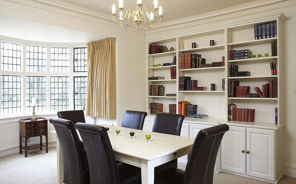 The dining room at Tempsford Mill oozes with elegance and features a large window and bookshelf