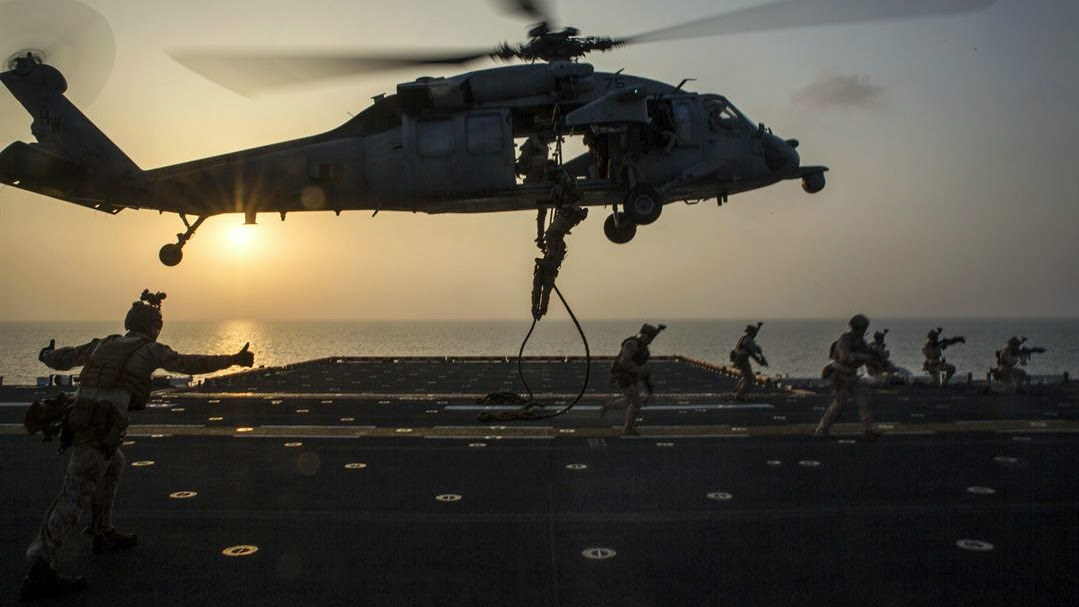 Marines fast-rope out of an SH-60 Seahawk during an exercise on the USS Bataan at sea, March 29, 2017. (Marine Corps/Brianna Gaudi)
