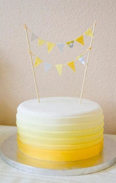 Round birthday cake with cicular yellow gradient bands and